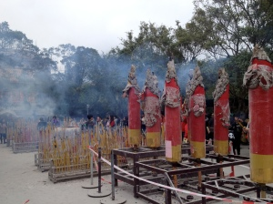 Giant incense sticks burning at the Po Lin Monastery located next to the Buddha