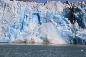 If you look closely, you will see that the whole face of the glacier is falling into the water.